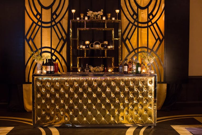 The Great Gatsby Party Themes Aren't Complete With out an Art Deco Gold Bar | PartySlate