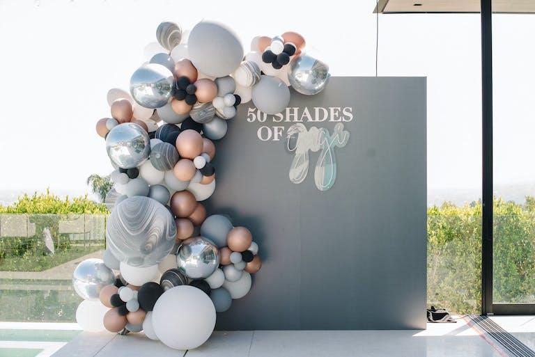 50 Shades of Gray-Themed Gray Birthday Backdrop With Metallic Balloon Installation | PartySlate