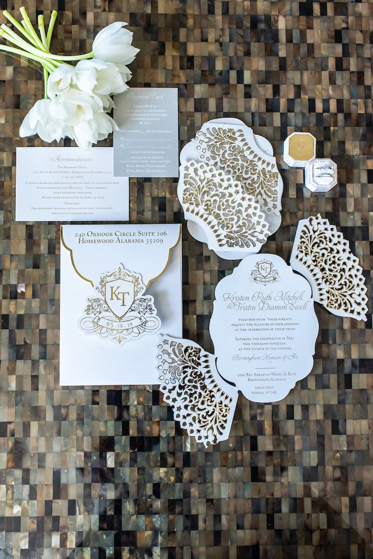 Gold and White Tri-Fold Wedding Invite With Coat of Arms Design | PartySlate