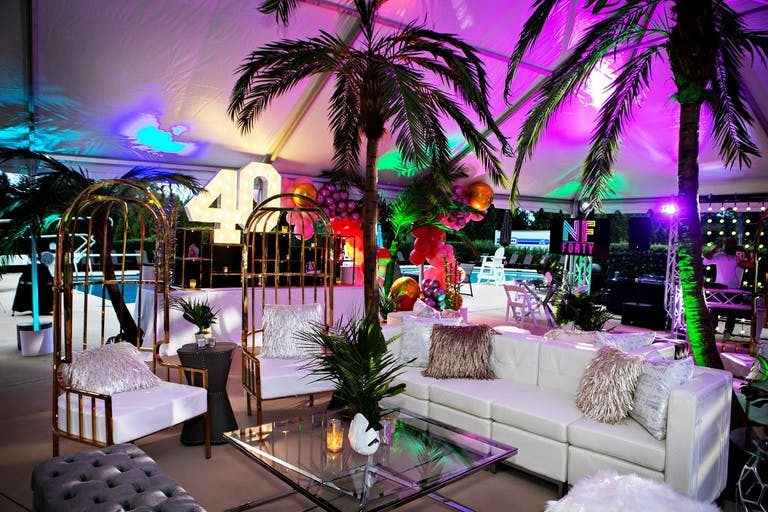 Chicago Tropical-Themed Birthday With Purple Uplighting and Palm Trees | PartySlate