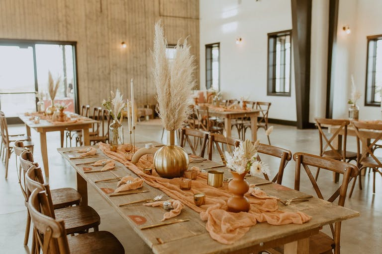 Modern Rustic Wedding With Eclectic Centerpieces, Pampas Grass, and Peach Linen | PartySlate
