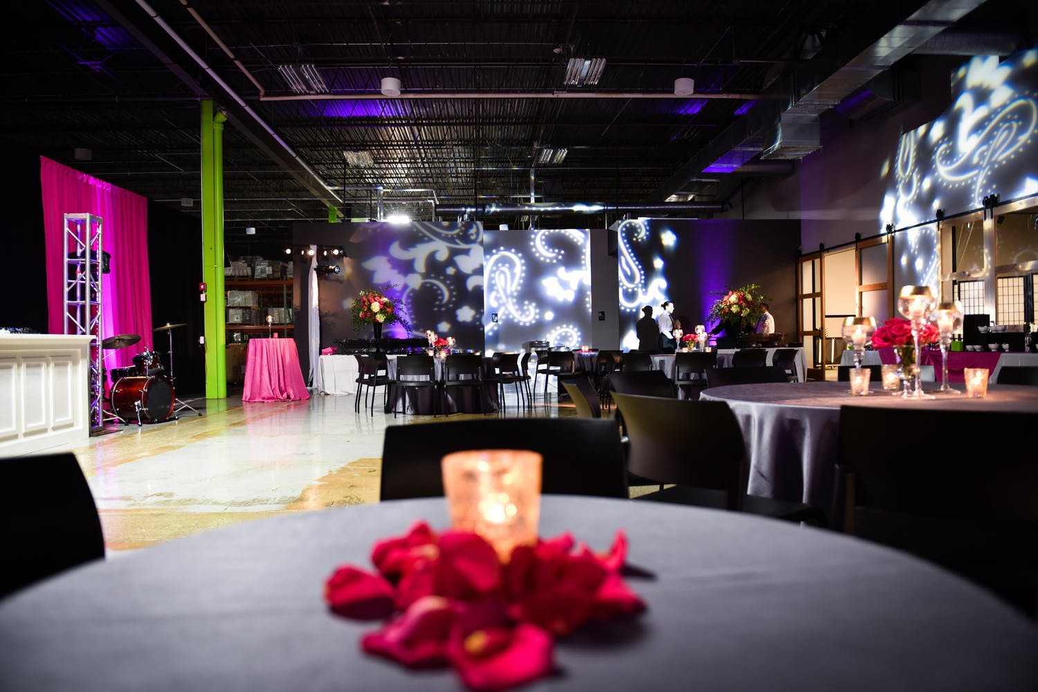 40th Birthday at industrial Venue With Paisley Wall Lighting | PartySlate
