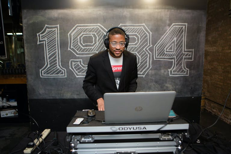 DJ Performs In Front of 1984 Chalk Signage | PartySlate