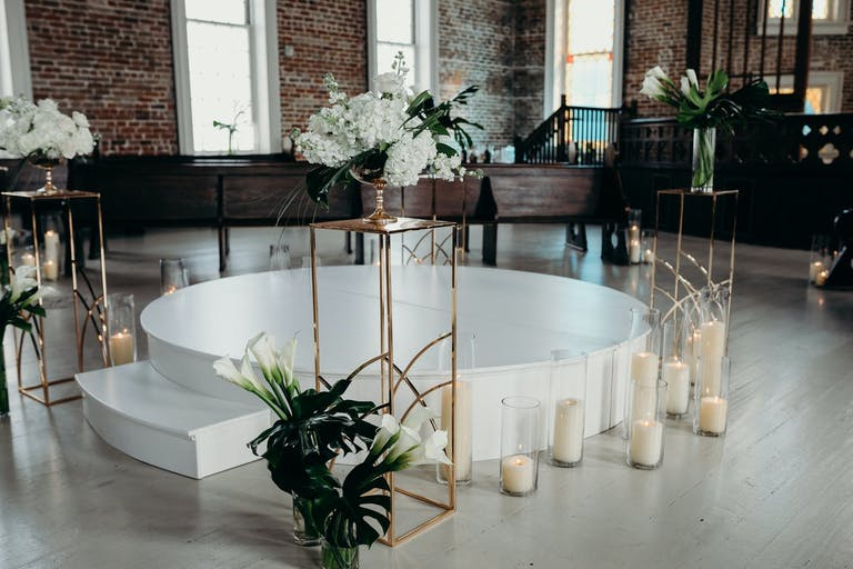 Modern Wedding Ceremony with Elevated Circular White Stand | PartySlate