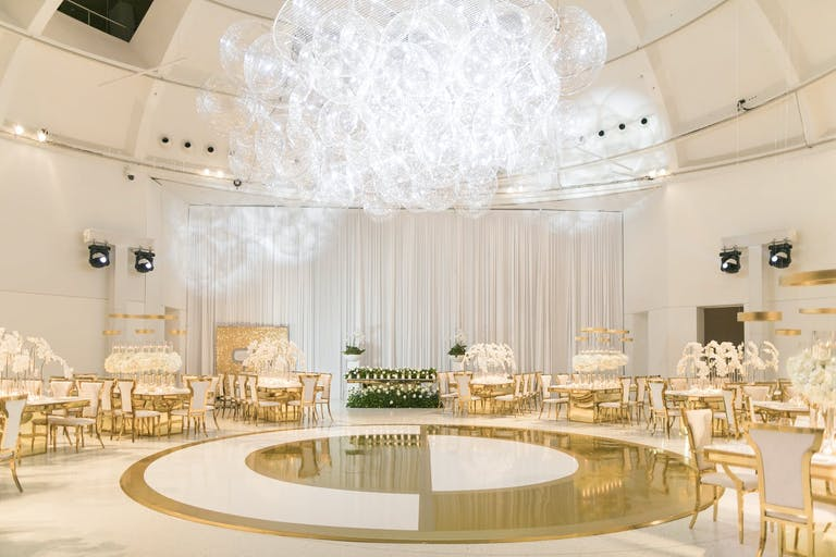 Wedding Ceremony With Yin and Yang-Inspired Gold and White Dance Floor and Lacey Bubble-Like Lighting installation | PartySlate