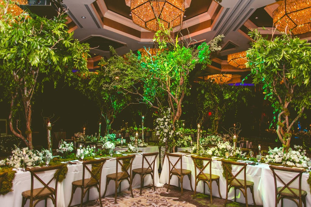 Indoor Enchanted Forest Wedding Theme With Towering Treetop Centerpieces and Amber Chandeliers | PartySlate
