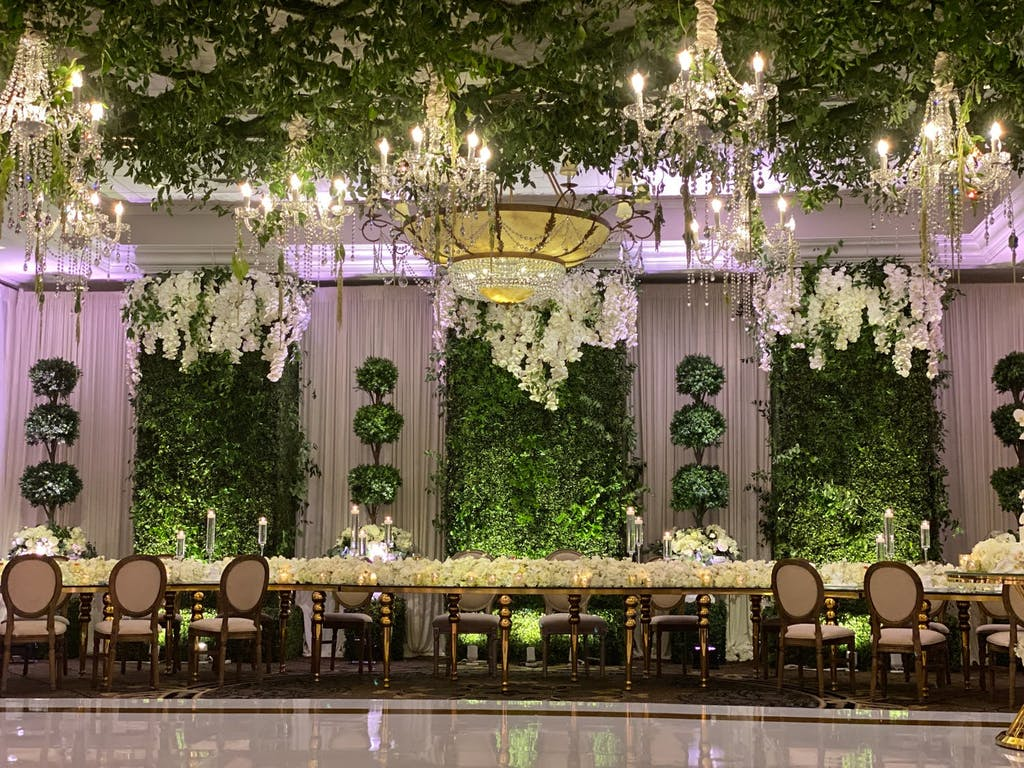Ballroom Enchanted Forest Wedding With Glittering Chandeliers and Greenery | PartySlate