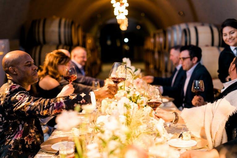 40th-Birthday Party Dinner Set Between Wine Barrel Walls | PartySlate