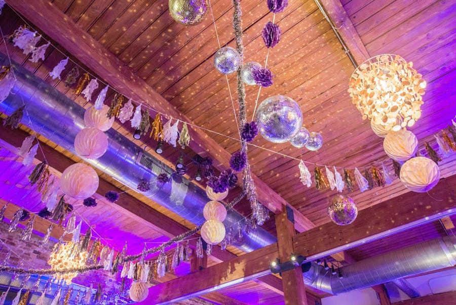 Birthday bash in Chicago with disco balls and purple ceiling decor | PartySlate