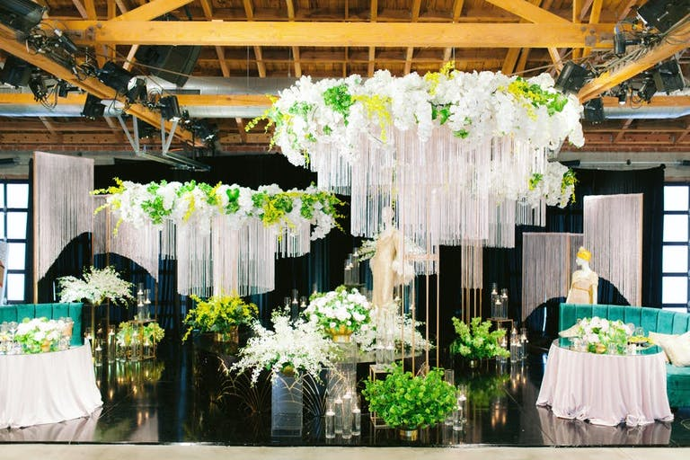 Great Gatsby Party With White and Green decor hanging from the ceiling | PartySlate