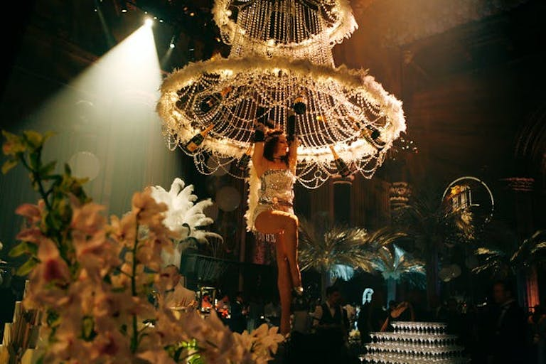 Gatsby Party With Entertaining Flappers Hanging From Feather Chandeliers | PartySlate