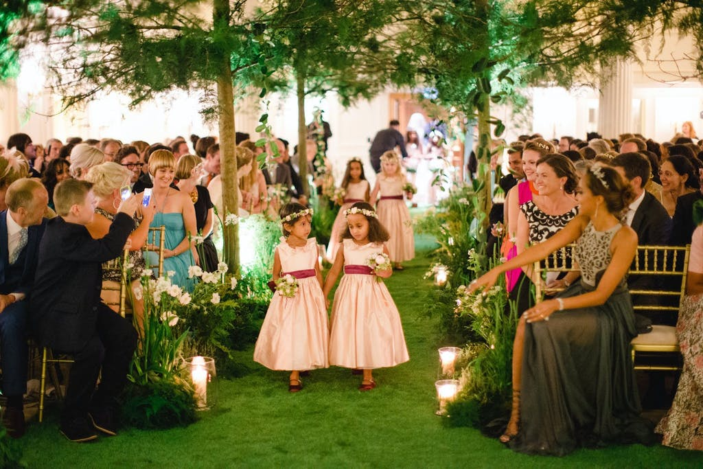 Enchanted Forest Wedding Themed Wedding Ceremony With Green Wedding Aisle | PartySlate