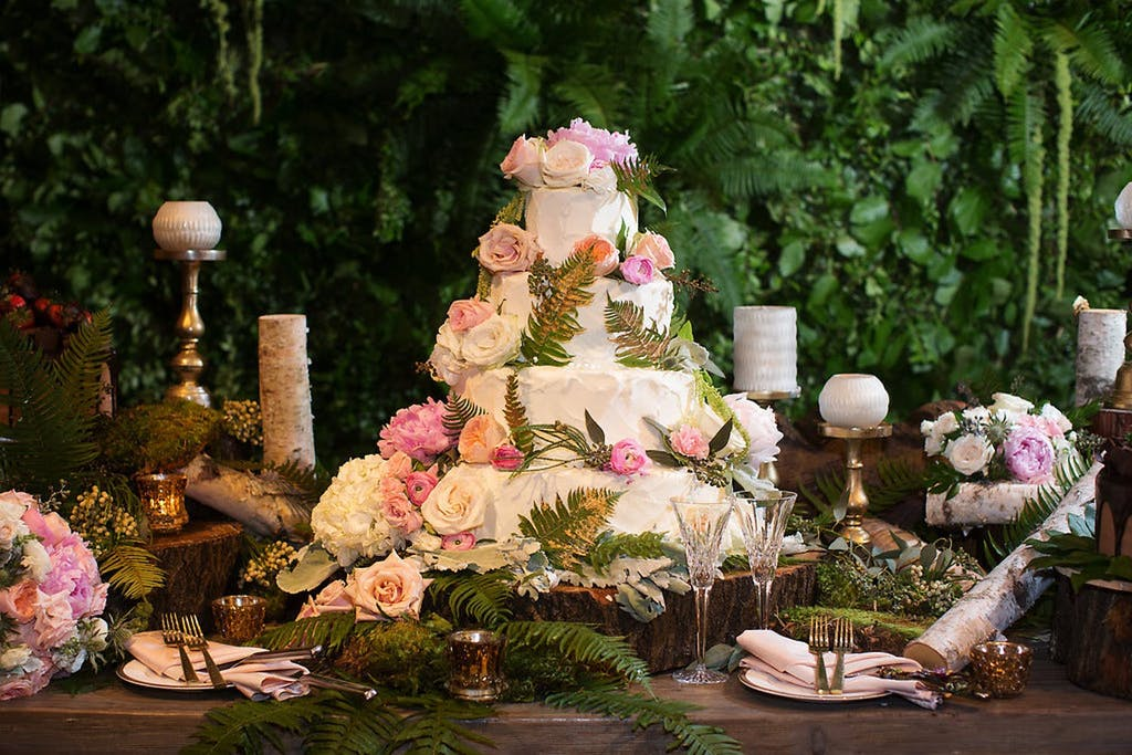 Enchanted Forest Theme Wedding Cake With Pink Roses and Ferns | PartySlate