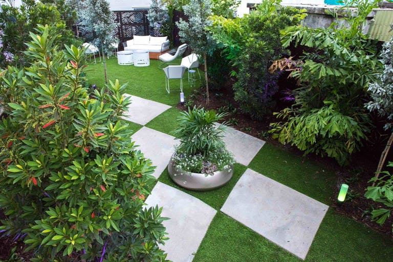 Outdoor event space in Miami with green turf and bushes | PartySlate