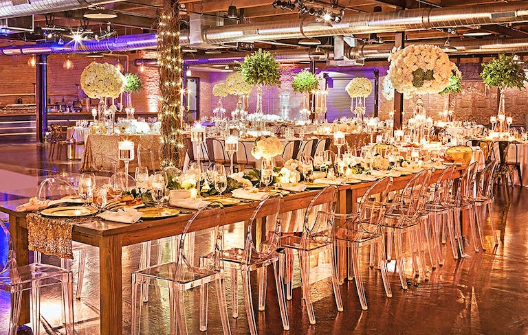 Wedding Reception With Acrylic Chairs and Tall Green and White Centerpieces at Morgan Manufacturing in West Loop Chicago | PartySlate