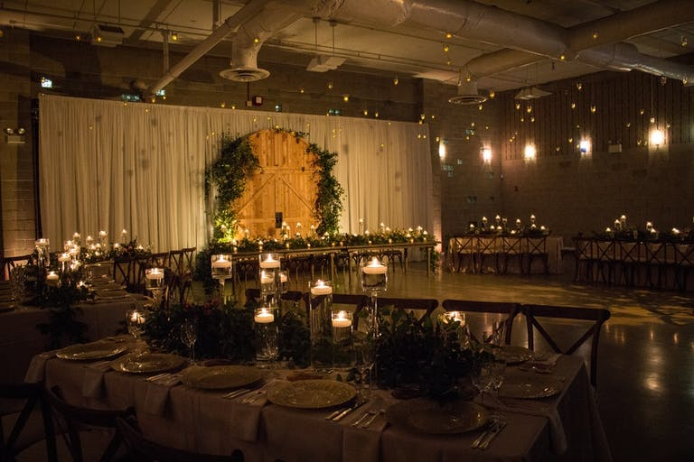 Romantic Candlelit Wedding Ceremony With Foliage at Ignite Glass Studio in West Loop Chicago | PartySlate