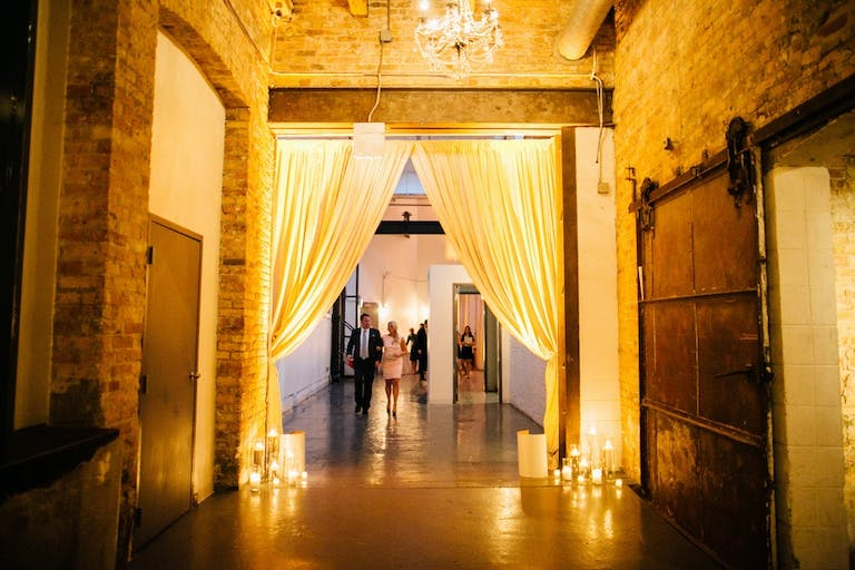 Chicago West Loop Wedding Venue Moonlight Studios With Gold Lighting and Candles | PartySlate