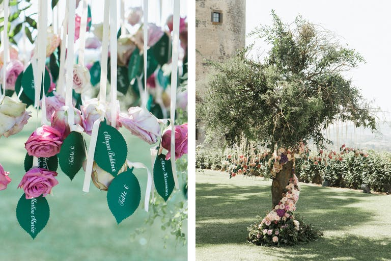 Floral Wrapped Tree With Suspended Leaf-Shaped Wedding Escort Cards and Ribbons Topped by Pink Flowers | PartySlate