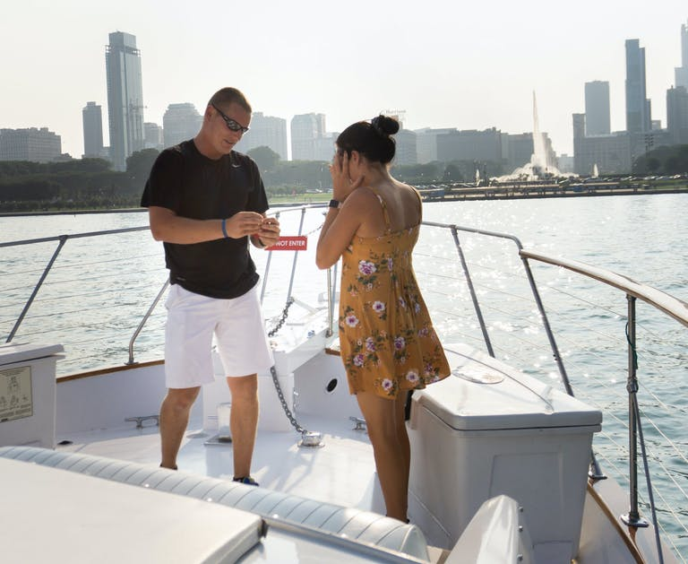 A Beautiful and Surprising Buckingham Fountain Yacht Proposal at Chicago Private Yacht Rentals in Chicago, IL