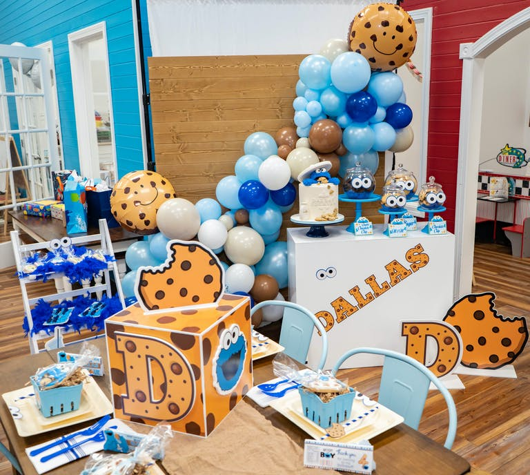 Kids Cookie Monster Themed 4th Birthday Party with Cookie Monster Cake and White Tan and Blue Balloons and Decorations | PartySlate