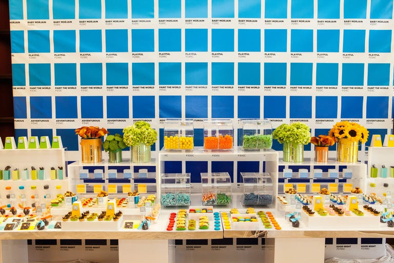 Colorful Creative Kids Birthday Party with Pantone Paint Swatches Filling the Walls Behind the Dessert Table | PartySlate