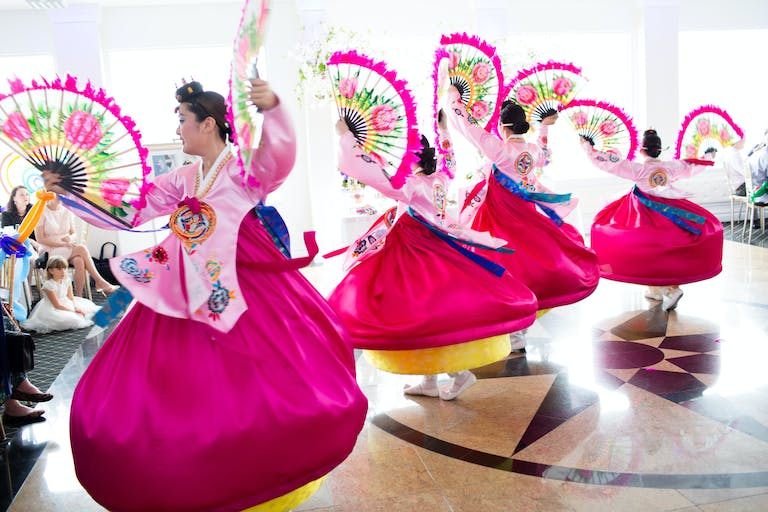 Delightful Pink and Green Kids First Birthday Party with Traditional Korean Performers Dancing | PartySlate