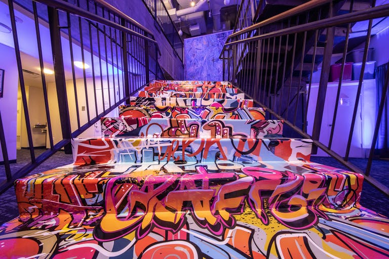 Hip Hop Graffiti Themed Kids Birthday Bash at Manhattan Movement + Art Center in New York with Graffiti on the Stairs and Walls | PartySlate