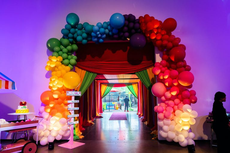 Marley Con Kids 2nd Birthday Party at AV Irvine in Irvine, CA with Colorful Balloon Arch Entrance | PartySlate