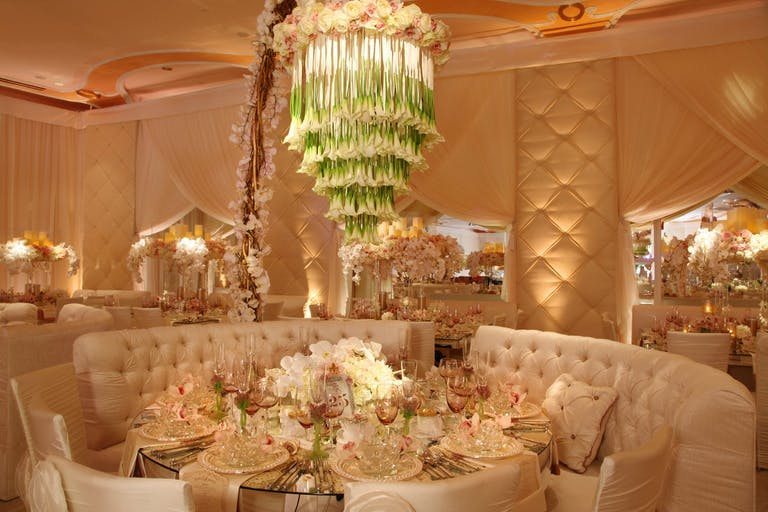 Ballroom Wedding in Peach Tones With Tulip Waterfall-Style Chandelier | PartySlate