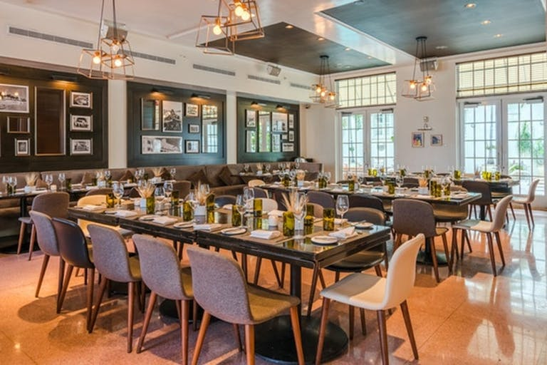 Private dining Miami is a must. Elongated tables, and natural light | PartySlate