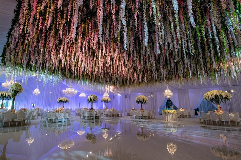 Wedding Ballroom With Mirrored Dance Floor and Floral Fringe Wedding Ceiling Decorations | PartySlate
