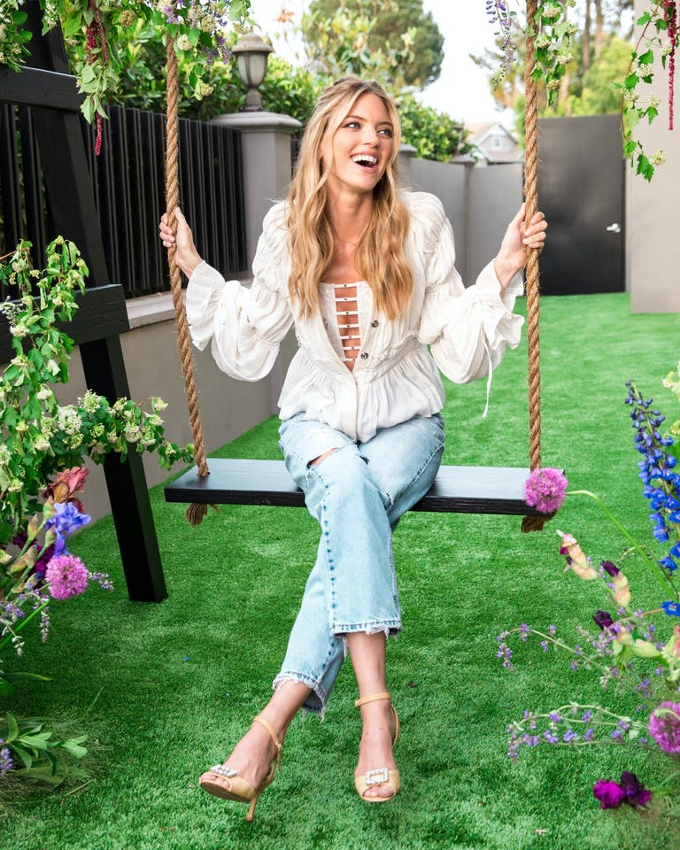 Young Woman Poses on Backyard Swing | PartySlate