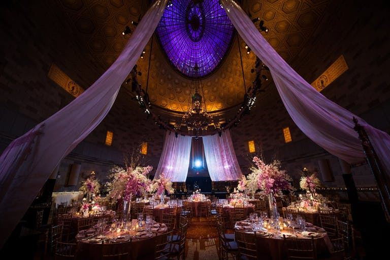 Dramatic Soaring Purple and Gold Ceiling With Ethereal Violet Wedding Drapery Suspended from Ceiling | PartySlate