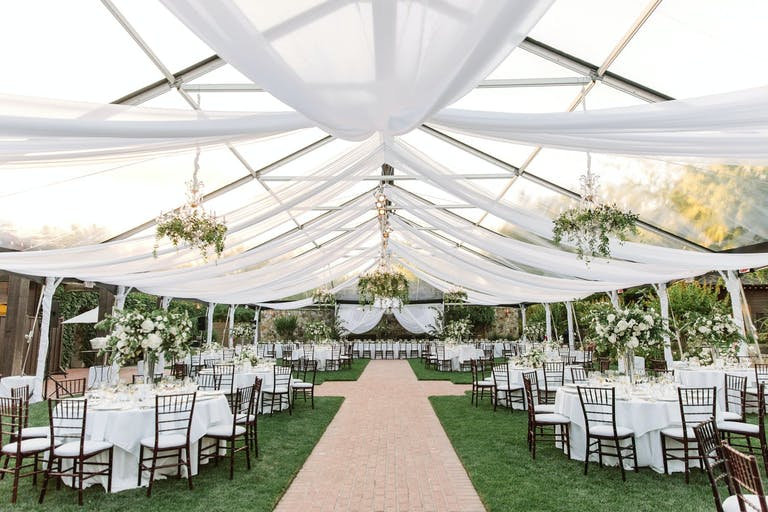 Transparent Wedding Tent Reception Area with Sheer White Ceiling Drapery | PartySlate