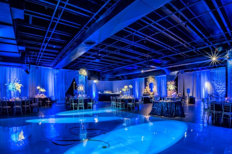 Blue Miami wedding venue space with LED light decor | PartySlate
