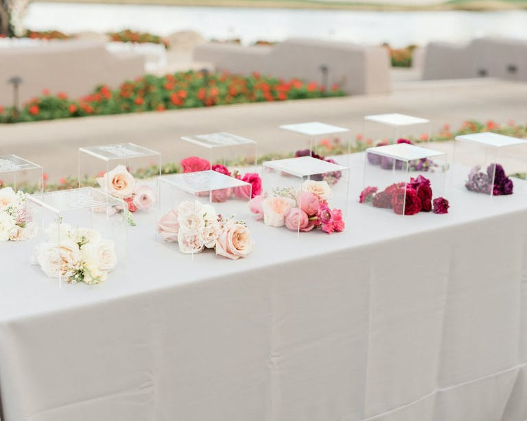 Lucite Boxes Inscribed With Wedding Table Numbers and Filled With Ombré-Hued Flowers | PartySlate