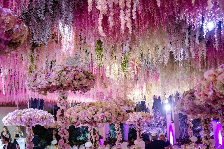 Wedding Reception With Lavish Floral-Fringe Ceiling Décor and Floral Parasol-Shaped Centerpieces | PartySlate