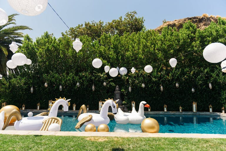 Backyard Pool Party With Unicorn and Swan Floaties | PartySlate
