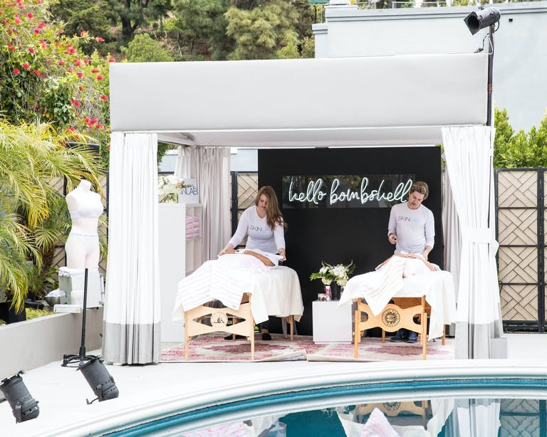 Massage Station at Poolside Victoria's Secret Party | PartySlate