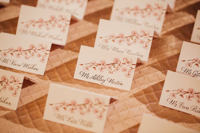 Wedding Escort Cards With Painted Cherry Blossom Designs | PartySlate
