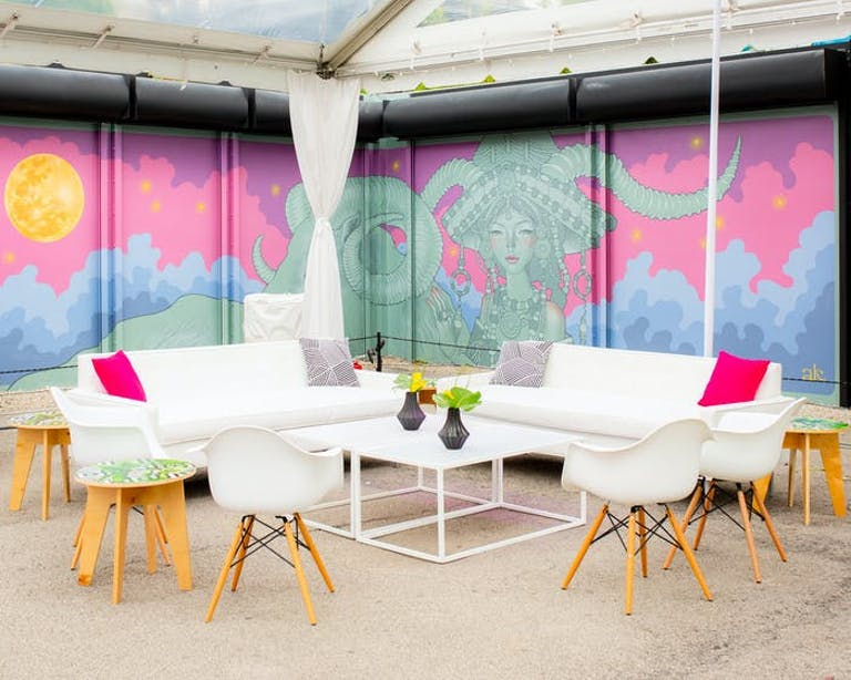 A Miami wedding venue space outdoors surrounded by murals | PartySlate