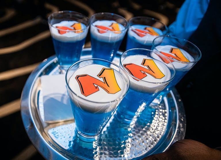 Blue and Orange 90's themed drinks on a serving tray | PartySlate