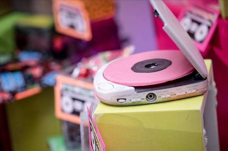 Retro CD player at a 90's themed party | PartySlate