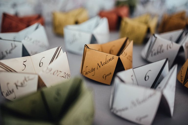 Red, Gold, Green, And Silver Origami-Inspired Fortune Teller Place Cards | PartySlate