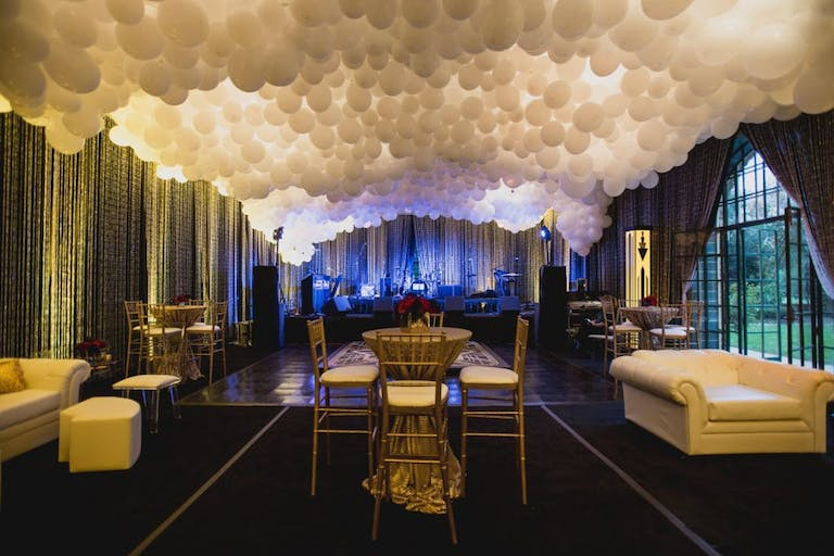 Gatsby-themed Birthday Party Venue With White Balloon Ceiling Installation | PartySlate