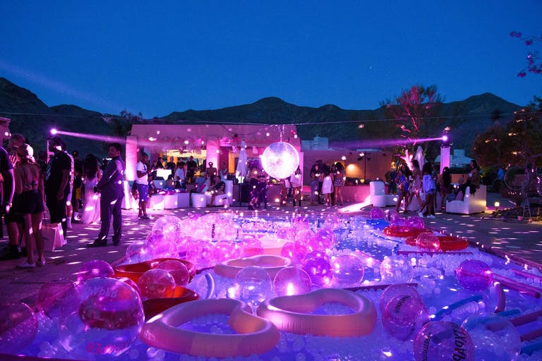 Nighttime Disco-Themed Pool Party With Iridescent Pool Floaties | PartySlate
