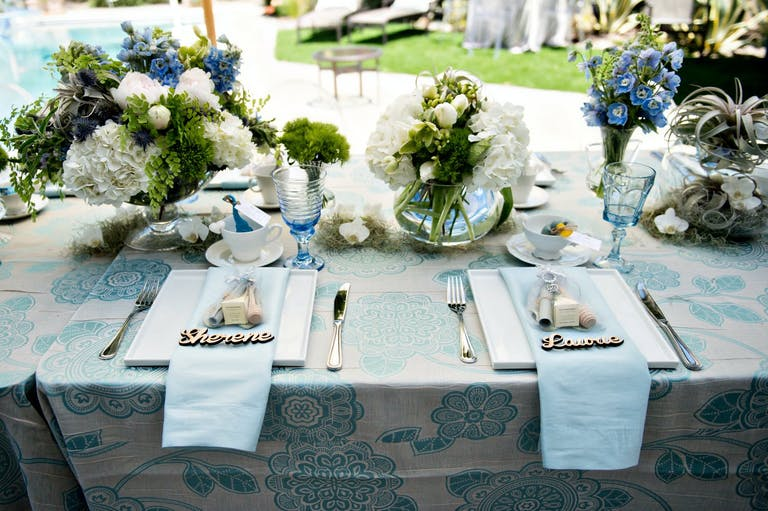 Rain-Themed Baby Shower Tablescape in Blue Color Palette With White Flowers and Greenery | PartySlate