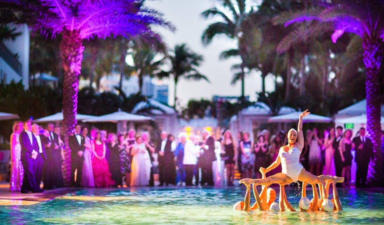 Water Ballerinas Perform in Pool at Wedding Party With Purple Uplit Palm Trees | PartySlate