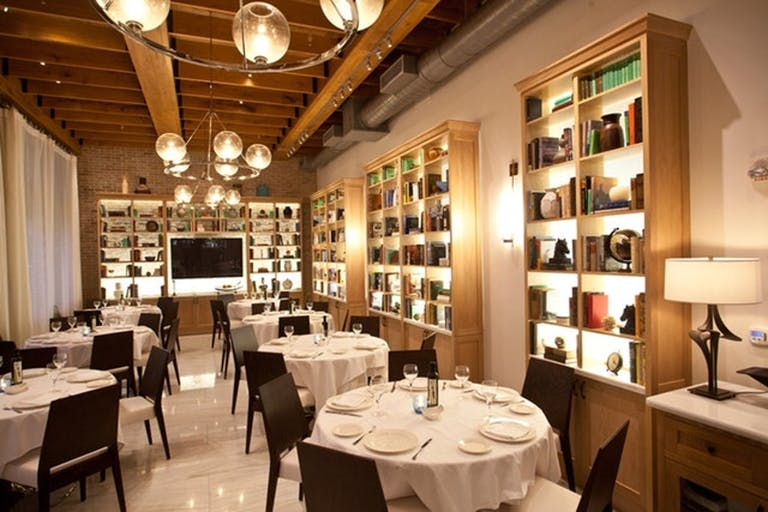 Estiatorio Milos Miami Private Dining With Cozy Light Color Palette and Book-Lined Shelving | PartySlate