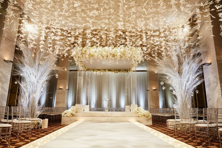 White Wedding Ceremony at The Standard Club With Butterfly Ceiling Installation | PartySlate